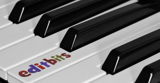 Editbits logo on a piano key